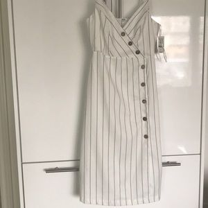 Small b/w striped dress with wooden buttons